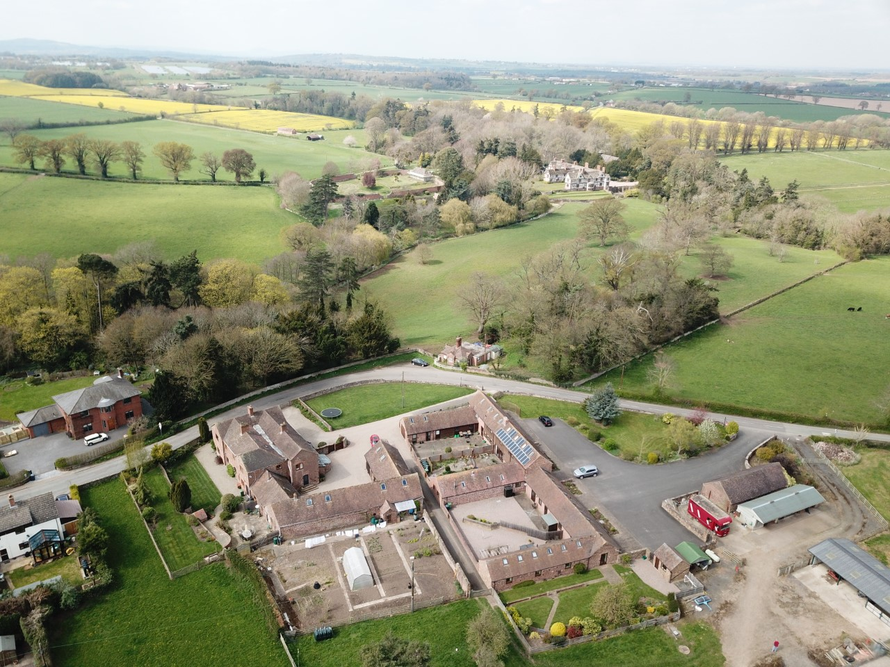 Aerial shot of Lower Farm Court and Pitchford Hall